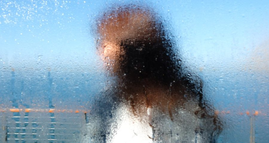 Blurred face of a woman by the sea