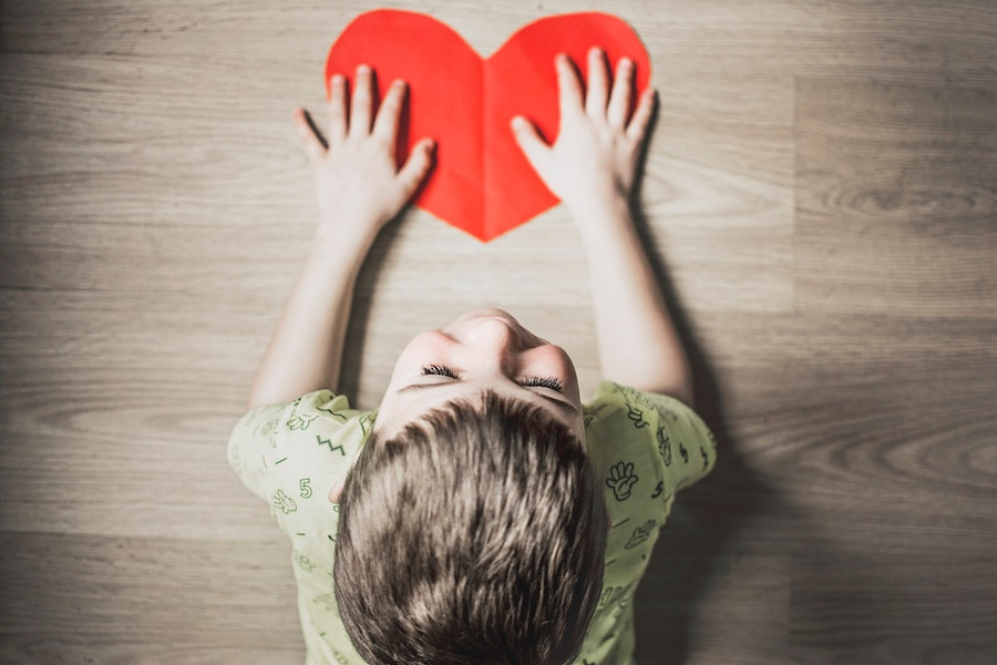 Boy giving heart