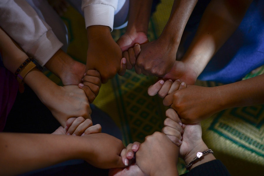 Linked hands forming a circle
