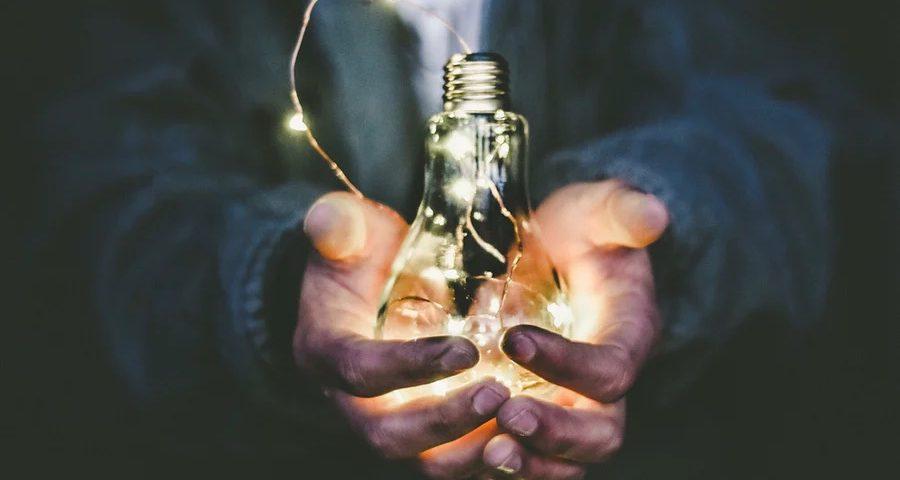 Light bulb in hands