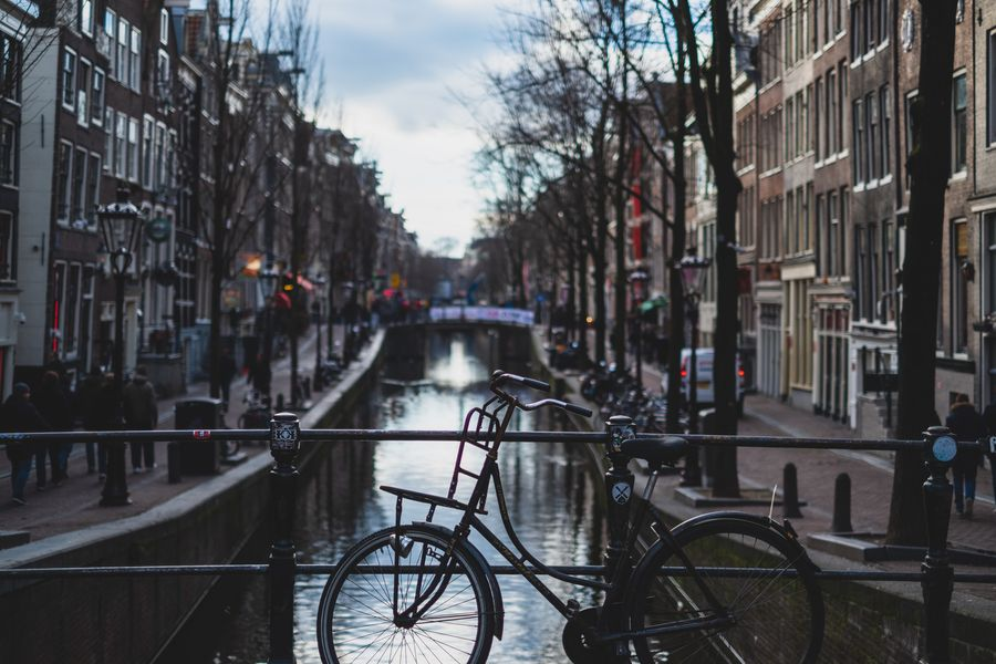 A bike on a bridge in Amsterdam. Photo by _ Harvey from Pexels