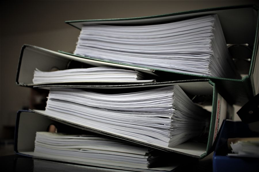 A stack of binders full of paper