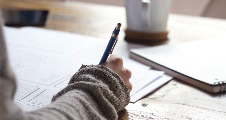 Woman writing with coffee